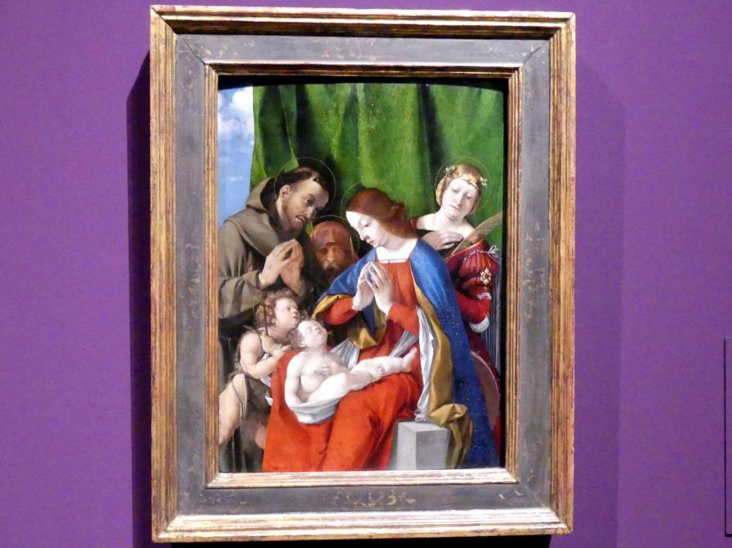 Lorenzo Lotto: Madonna, das Kind anbetend, mit Heiligen, um 1508
