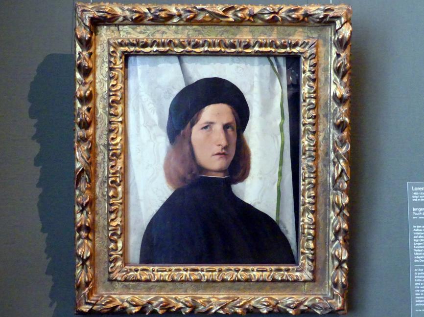 Lorenzo Lotto: Junger Mann vor weißem Vorhang, um 1508