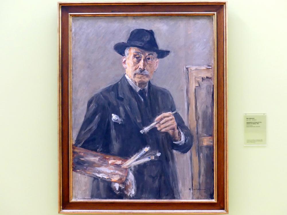 Max Liebermann: Selbstbildnis im Anzug mit Hut, stehend mit Palette, 1927